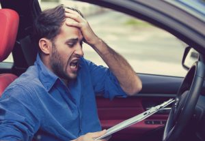 distressed man in a car because of a mistake